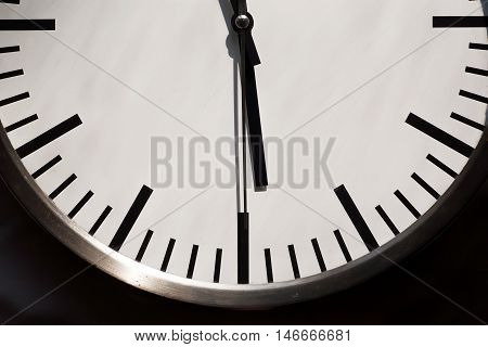 Half of the round form dial with clock hands. Fragment of big clock dial.