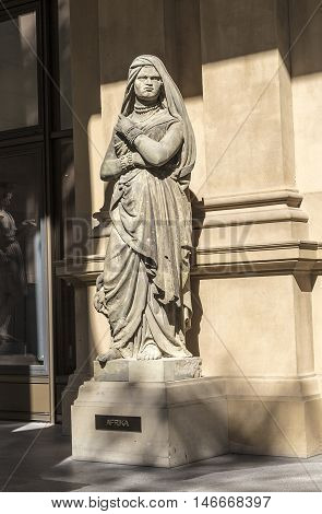 sandstone statue at frankfurt stock exchange that symbolizes the african continent