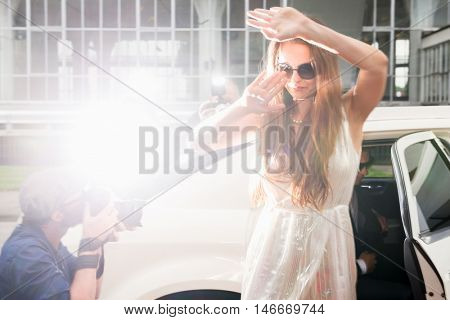 Elegant Woman Hiding Her Face From Paparazzi At Red Carpet