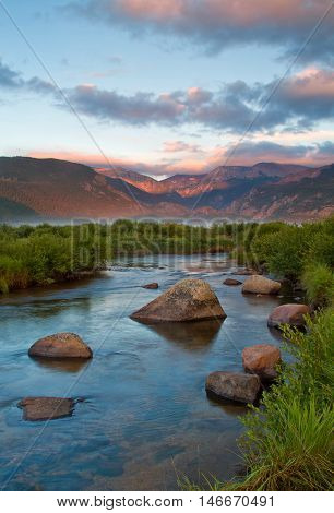 Sunrise on The Big Thompson River and Moraine Park while a fog bank hovers over the meadow