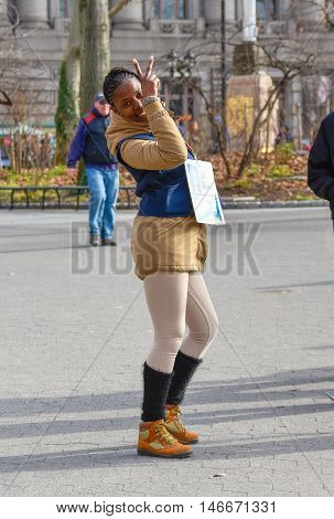 NEW YORK, USA - DECEMBER 28, 2015: Tour agent to Statue of Liberty in Battery Park.