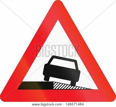 Warning Road Sign Used In Denmark - Sloping Shoulder