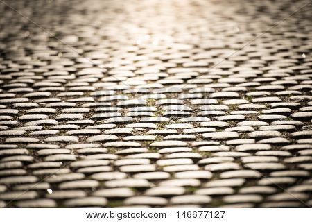 Close up view of cobblestone street in Gamla Stan Stockholm Sweden Scandinavia Europe.