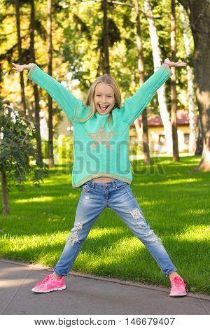 Little Positive Girl Having Fun . She's Happy .