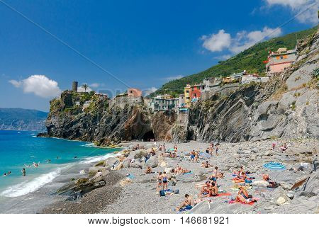 Vernazza Italy - July 29 2016: Municipal pebble beach in the old village of Vernazza. Parco Nazionale delle Cinque Terre Liguria Italy.