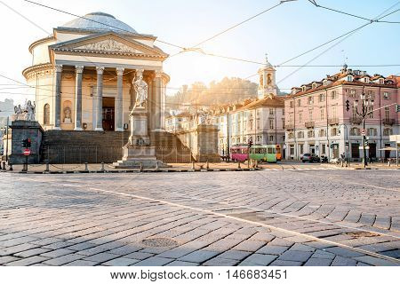 Turin cityscape view on Gran Madre square with church and Vittorio Emanuele statue in the morning