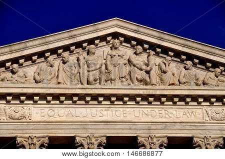 Washington DC - April 9 2014: Allegorical figures including Justice (center) decorate the neo-classical pediment on the west front of the United States Supreme Court