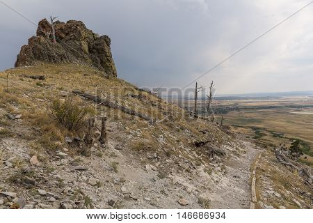 A scenic butte landscape with a hiking trail.