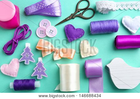 Flat lay of handcraft in purple tones on colour background