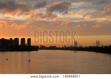 Cable stayed bridge and Neva river on the outskirts of St. Petersburg at sunset Russia.