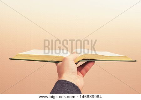Open Vintage Book In Male Hand, Old Style Photo