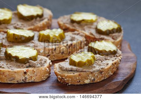 bread with liver pate and pickle cucumber