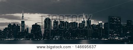Midtown Manhattan skyline at dusk panorama over East River in BW