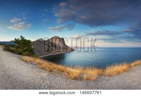 Beautiful Panoramic Landscape With Mountains, Path, Yellow Grass, Sea