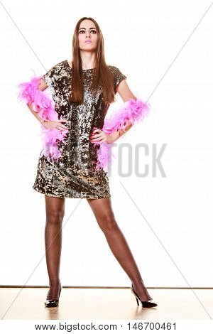 Party new year celebration and carnival concept. Elegant woman in evening sequin dress pink feather boa isolated on white background.