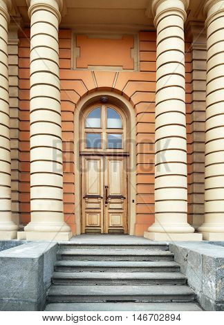 porch with a door and facade of the building in St. Petersburg, Russia
