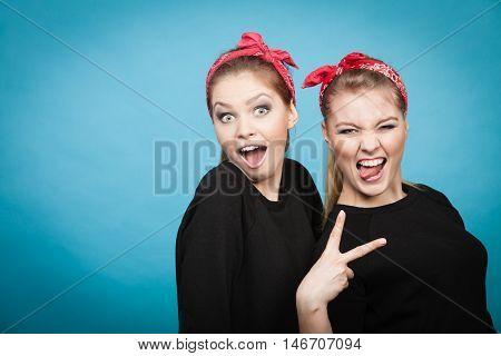 Craze fun and positive madness. Women showing their funny faces feel carefree. Girls in retro pin up fashion style present crazy behave.