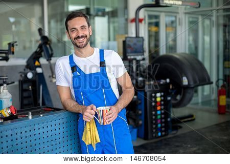 Satisfied male mechanic in an auto repair shop