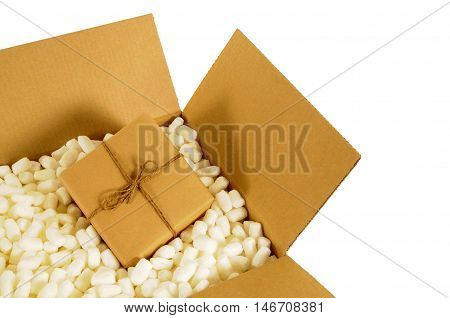Cardboard shipping box with small wrapped package inside