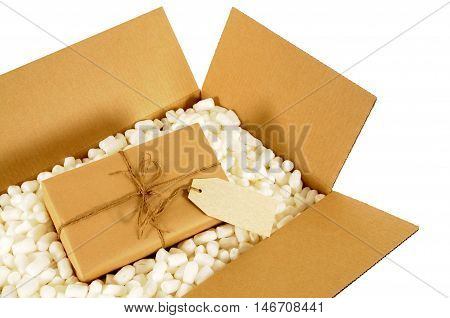 Cardboard delivery box with brown paper mail package and polystyrene packing pieces.