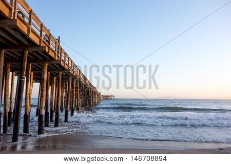 Historic wooden pier in city of San Buena Ventura at golden hour Southern California