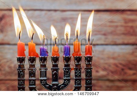 Jewish holiday Hanukkah creative background with menorah. View from above with focus on menorah. Retro filter effect.
