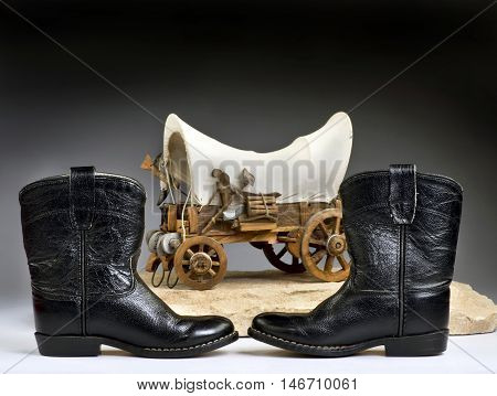 Kids cowboy black boots and chuck wagon with room for your type.