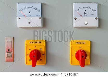 Volt meter switching button on electric control panel.