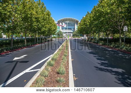 Cupertino, CA, USA - August 15, 2016: road to Apple world headquarters at One Infinite Loop. Apple is a multinational that produces consumer electronics, personal computers and software.