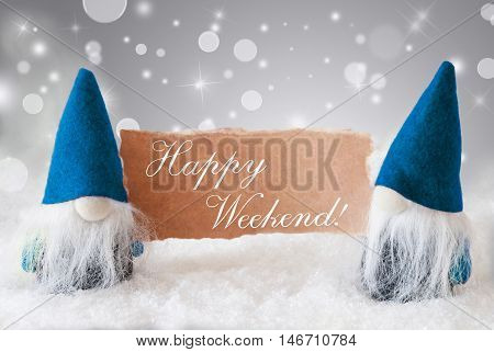 Christmas Greeting Card With Two Blue Gnomes. Sparkling Bokeh And Noble Silver Background With Snow. English Text Happy Weekend