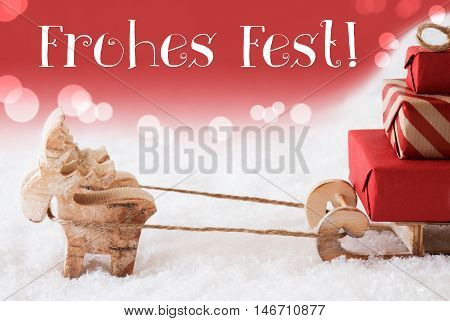 Moose Is Drawing A Sled With Red Gifts Or Presents In Snow. Christmas Card For Seasons Greetings. Red Christmassy Background With Bokeh Effect. German Text Frohes Fest Means Merry Christmas