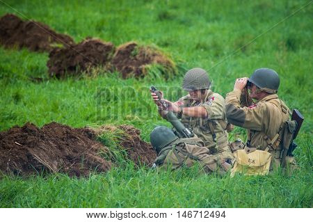 US Army mortar team in action. Shot at