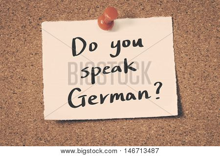 Do you speak German? note pin on the bulletin board