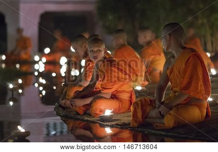 Chiang Mai, Thailand - May 20: Thai Buddhist Monks Meditate With .candle Lighting During The Religio