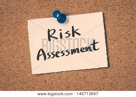 Risk Assessment note pin on the bulletin board