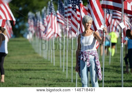 Saint Louis, MO - September 11, 2016: More than 7,000 flags with name, photo and dog tag of soldier killed defending the United States wave outside the St. Louis Art Museum in Saint Louis, Missouri