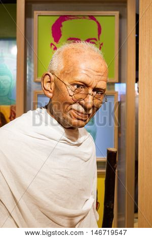 BANGKOK THAILAND - DECEMBER 19: Wax figure of the famous Mahatma Ghandi from Madame Tussauds on December 19 2015 in Bangkok Thailand.