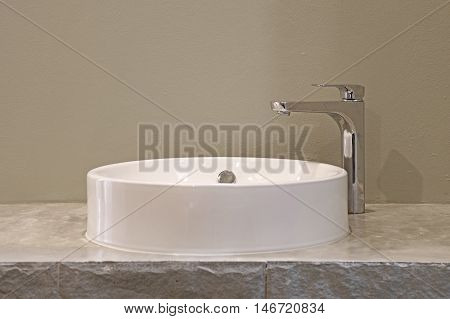 Ceramic Washbasin And Metal Faucet