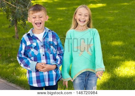 little boy and girl laugh . They're having fun . Children's emotions and impression