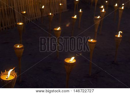 Closeup Group of burning candles in thai style.