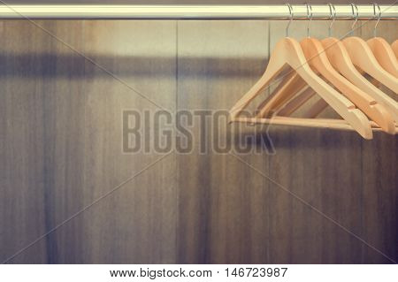 Clothes hanger in wardrobe. Text space available.