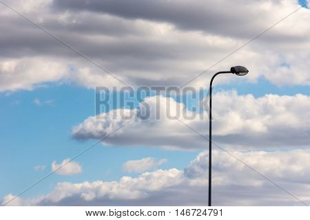 The Lamppost Stands Alone Against The Blue Sky