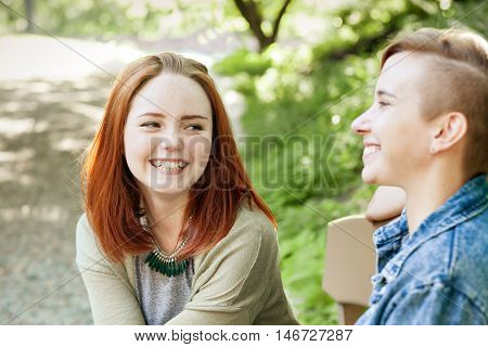 LGBT women. Young lesbian couple walking in the park together. Delicate relationship. The notion of same-sex marriage. Selective focus.