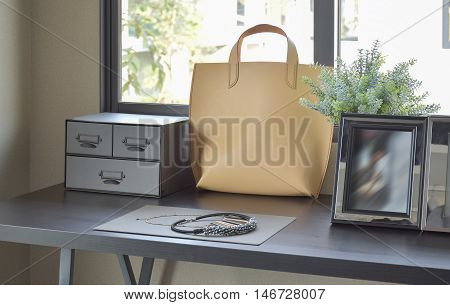 Female's Accessories With Handbag And Jewelry On Wooden Dressing Table