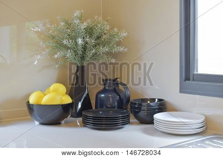 Modern Pantry With Black And White Utensil In Kitchen
