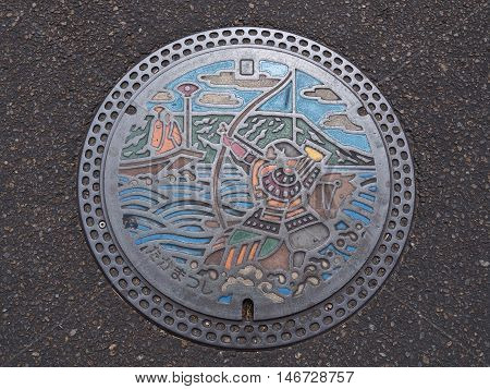 KAGAWA, JAPAN - JULY 22, 2016: A manhole cover in Takamatsu, Kagawa, Japan. Nasu no Yoichi, who particularly famous for his actions at the Battle of Yashima in 1184 was engraved on a manhole cover.