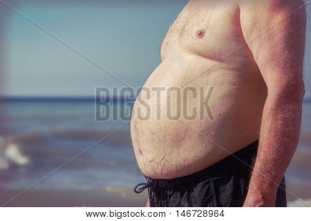 Overweight stomach at the beach