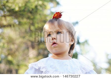 Little girl with ponytail portrait looking forward