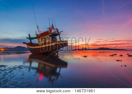 Fishing boat at sunrise time on the Rawai beach Phuket Province Thailand