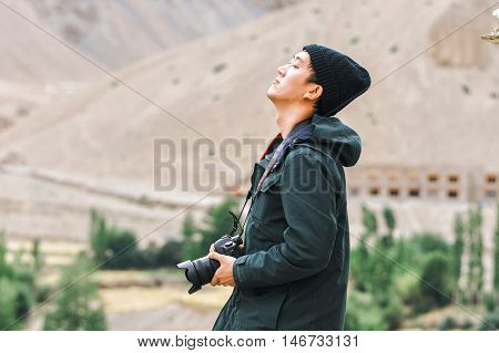 Asian Travel Photographer Relaxing And Breathing In Mountain